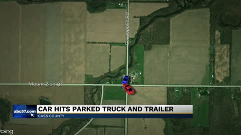 Car hits parked truck and trailer in Cass County